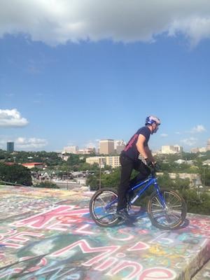 Cyclist Danny MacAskill rides at Austin's Castle Hill Graffiti wall to promote Epecuen.