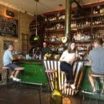 Patrons seated at Austin's Eastside Showroom Bar