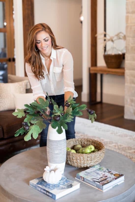 Interior decorator arranges floral design